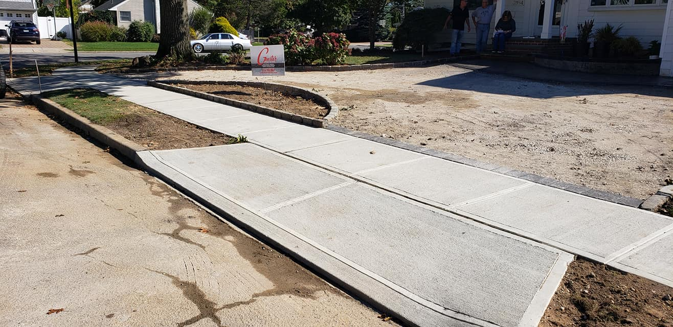 concrete sidewalk and drive
